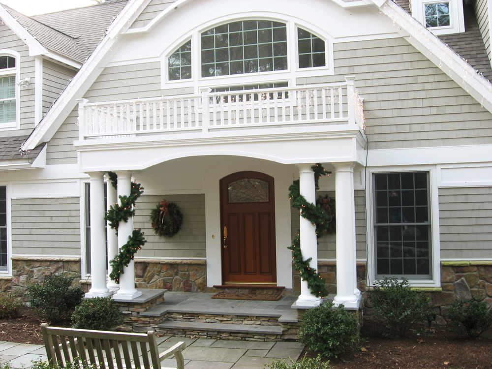 Entryway with balcony and columns decorated for Christmas