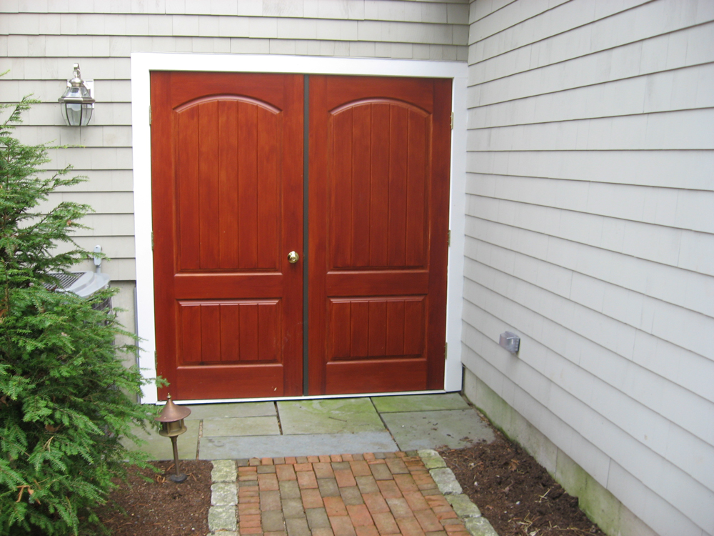 custom front doors - almost a barn look