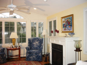 living area with large windows and fireplace