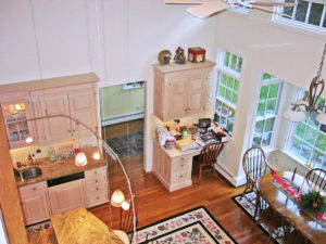 aerial view of the edge of the kitchen and a wall of windows