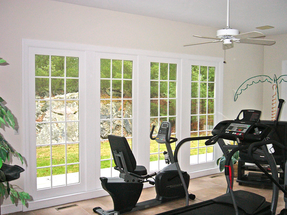 These homeowners can get their inspiration to exercise from the great view out their custom windows!