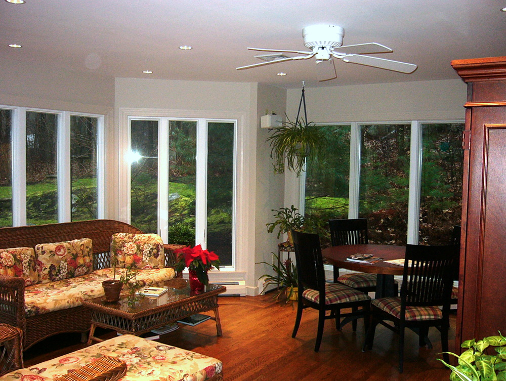 More floor to ceiling windows showcasing the beauty of the outdoors.