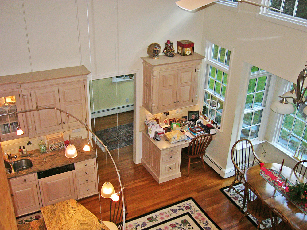 This two story space is spectacular. Don Wright has brought the natural light to every level.