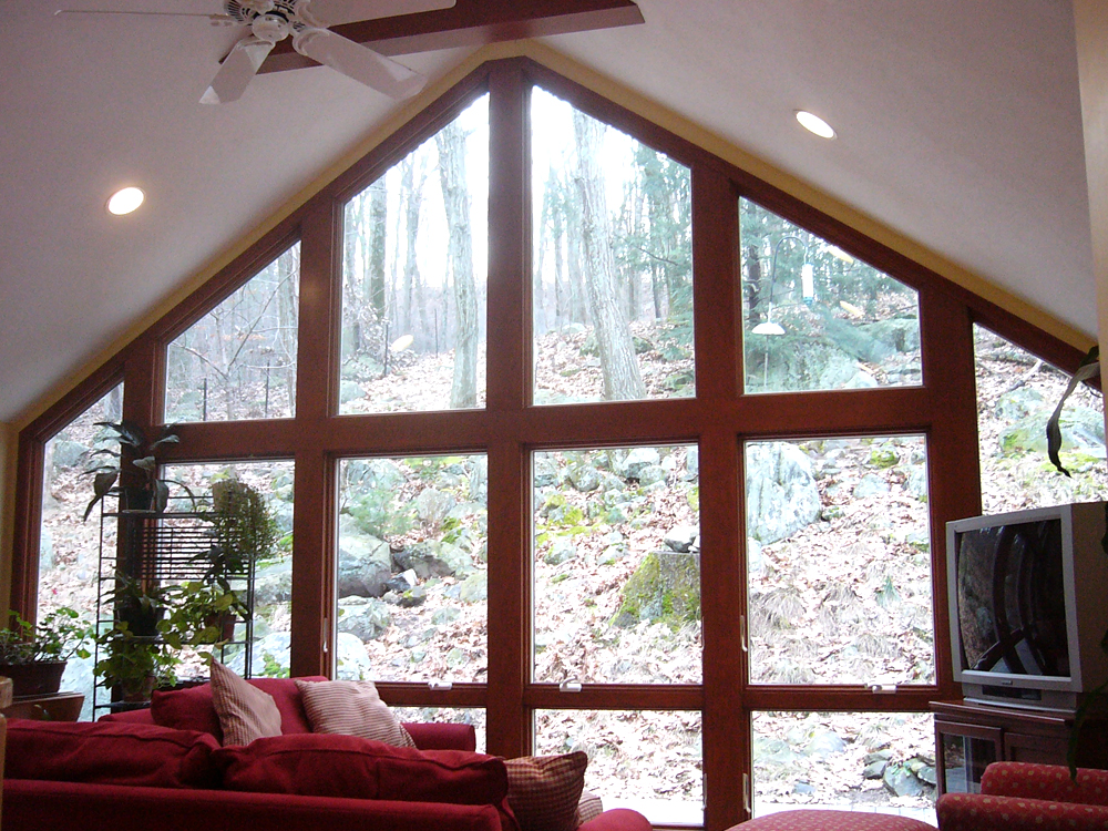 Besides the great customized windows, notice the beams and skylights, all put together perfectly.