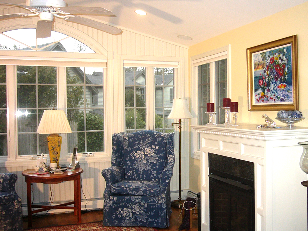 another view with blue upholstered chairs and fireplace