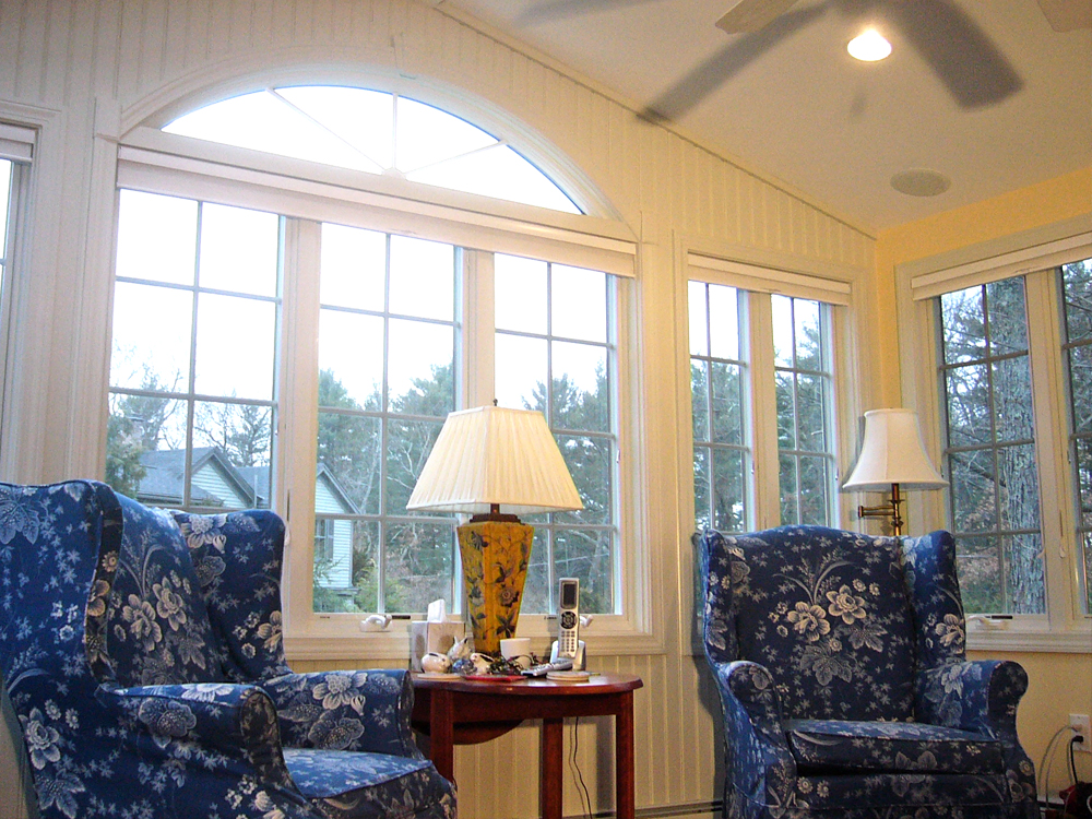 another view of sunroom with blue stuffed chairs
