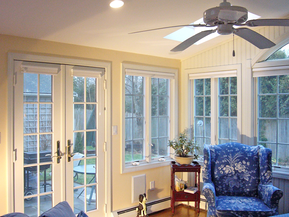 sunroom with stuffed chairs