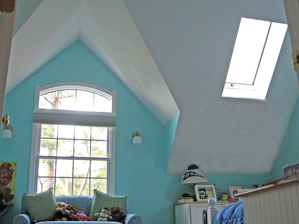 Another example of how Don Wright customizes ceiling angles, skylights and windows to make this room perfect!