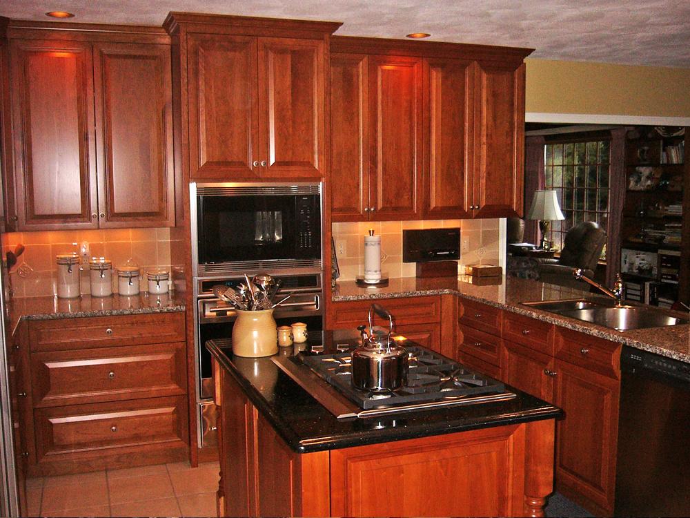 stove island, cherry cabinets.