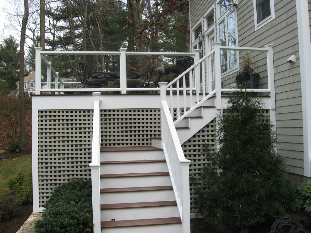 The glass on the deck offers unobstructed views of the backyard. And the stairs are solidly built, and attractive!