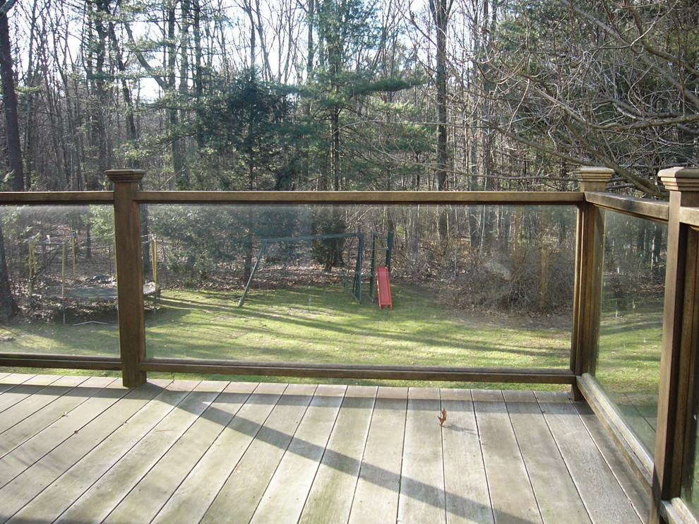 These glass railings with the natural wood look provide a view of the kids without sacrificing beauty or function.