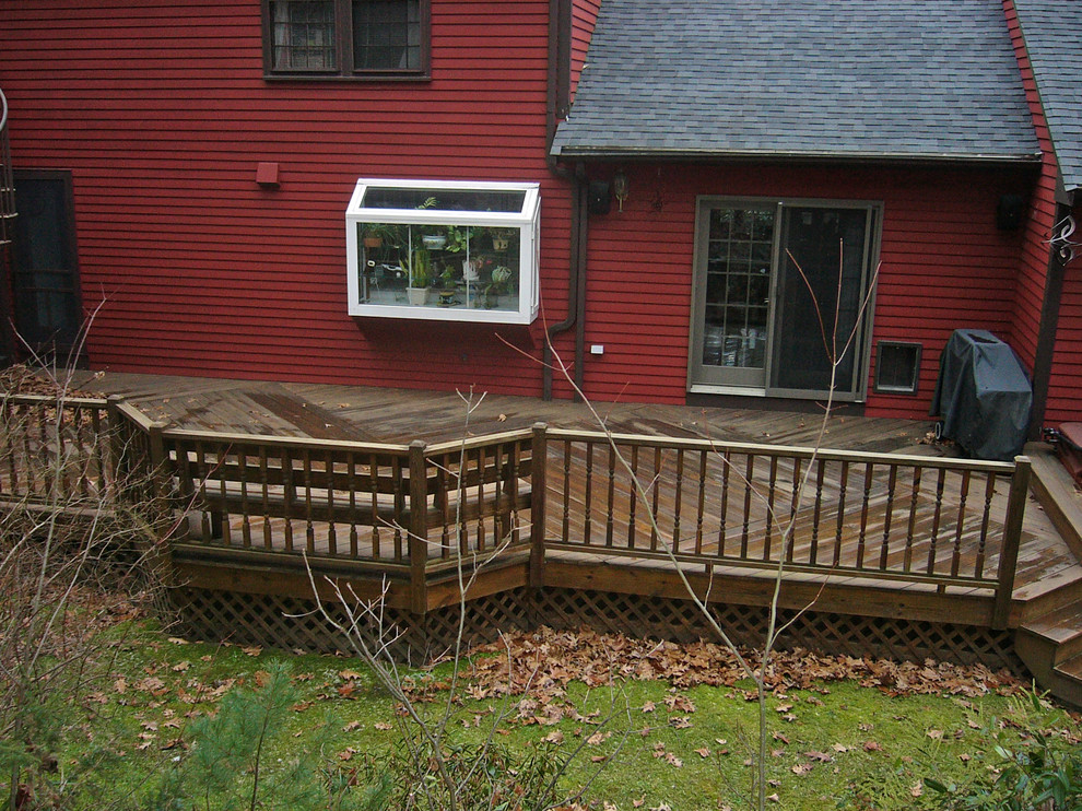 The railings, floor patterns and railings all add up to a beautiful, natural wood deck!