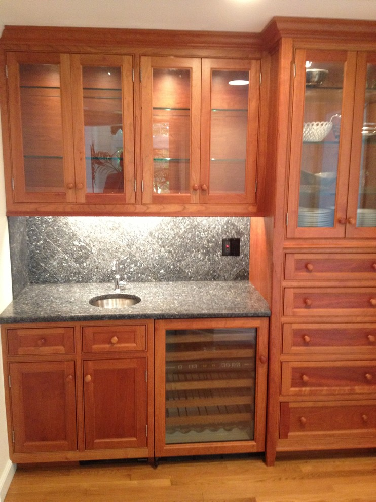 An extra working sink and beautiful custom cherry cabinets.