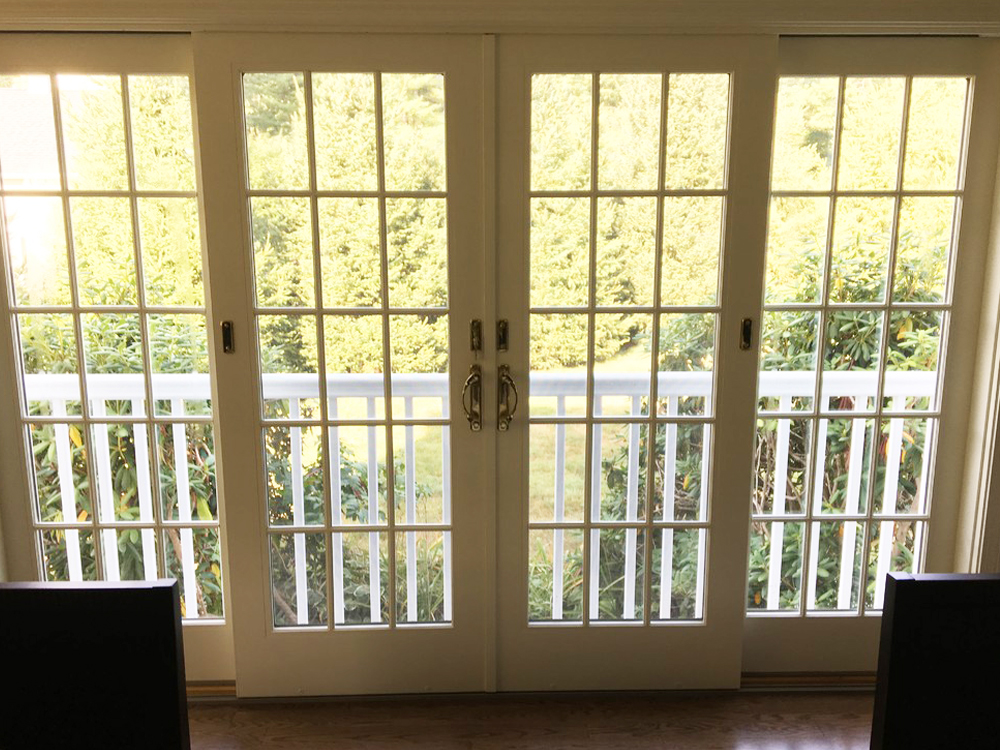 These great french doors bring in natural light fresh air, and access to the new balcony.