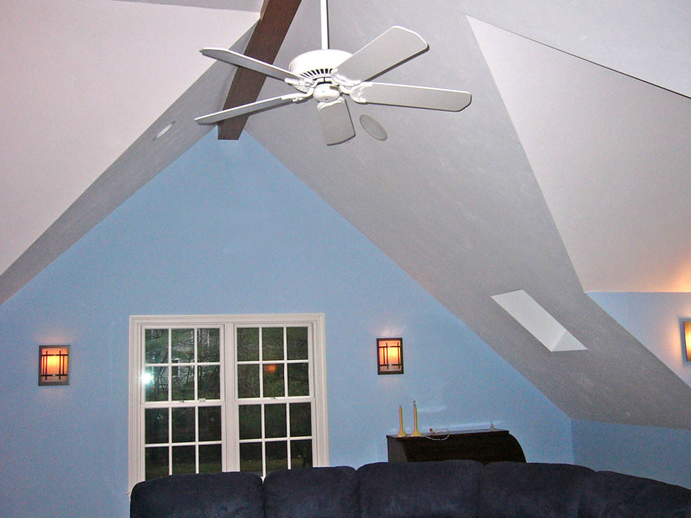 Family room - Windows and skylights, ceiling fan and lovely peaks