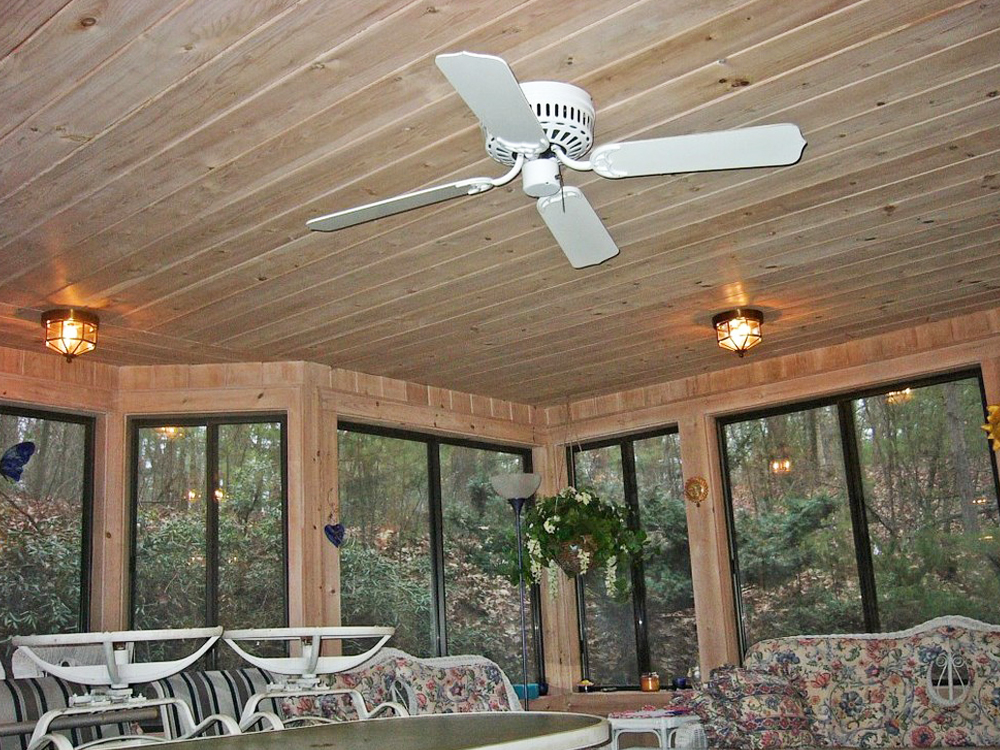 The custom angles, windows and woodwork make this sunroom the place to be on a warm night!