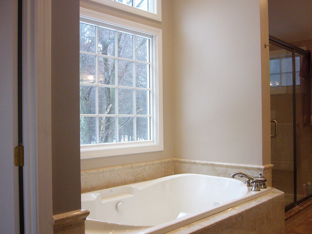 This Jacuzzi tub, with the large window, will be a favorite place for the homeowner! With Don Wright's typical skill, the bathroom is also beautiful with the stone tile and glassed shower.