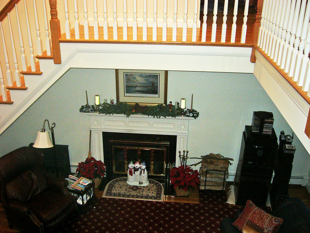 This view demonstrates how the balcony brings the upstairs and downstairs together with elegance!