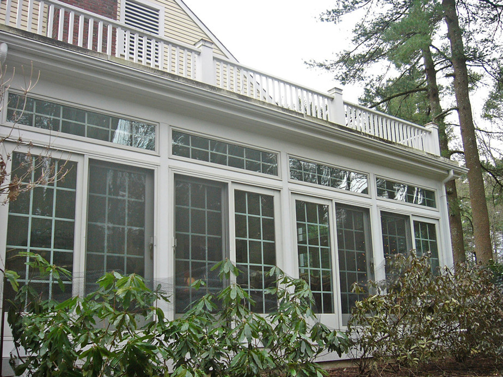 Elegant and beautiful, this sunroom has the details we associate with the good life! All of those windows, including the the line of small windows at the top, make this another beautifully crafted Don Wright creation. The indoor natural lighting, and the outdoor elegance are just right.