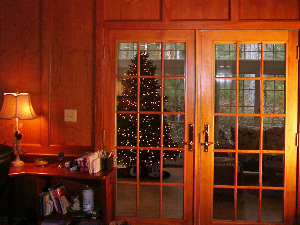 The customized wood paneling and french doors match perfectly.