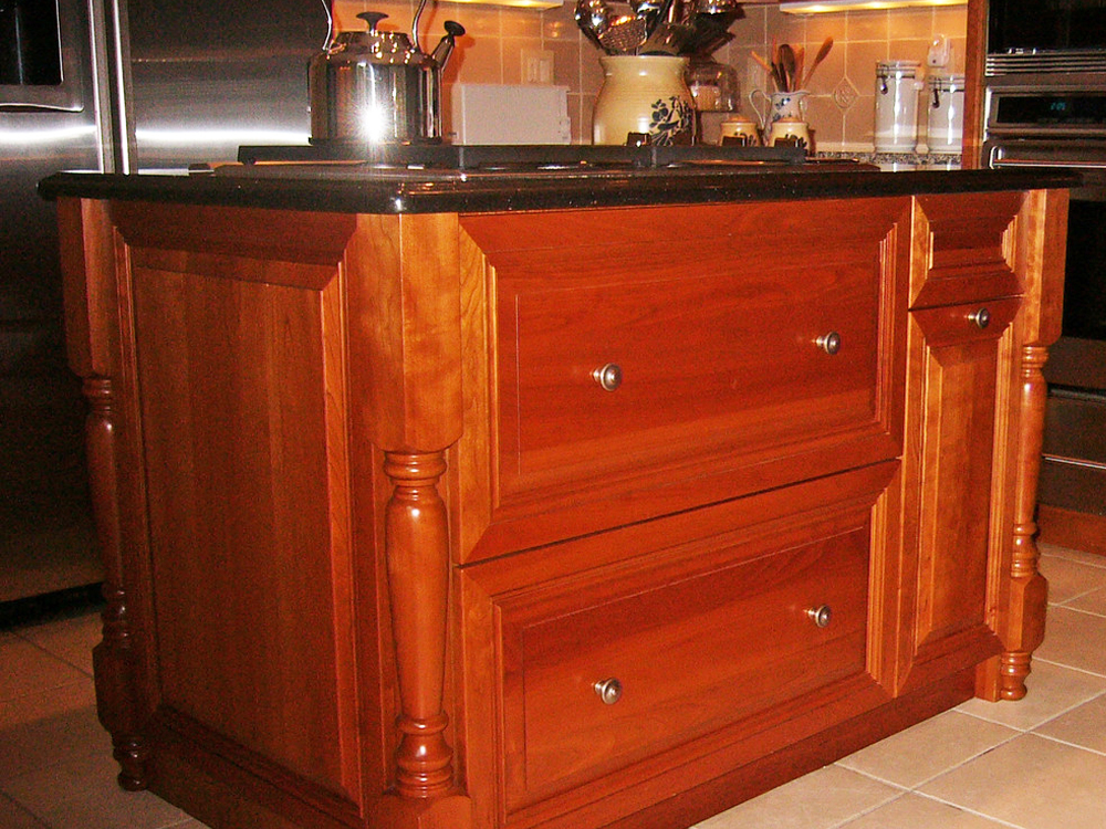 This island is one of a kind - custom drawers and cabinets, along with legs! The look is complete with furniture quality wood finish! Lovely!