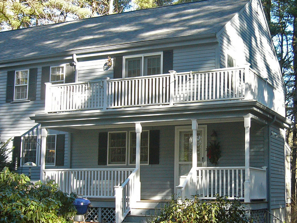 The matching porches, upstairs and down, bring new beauty and function to a traditional colonial!