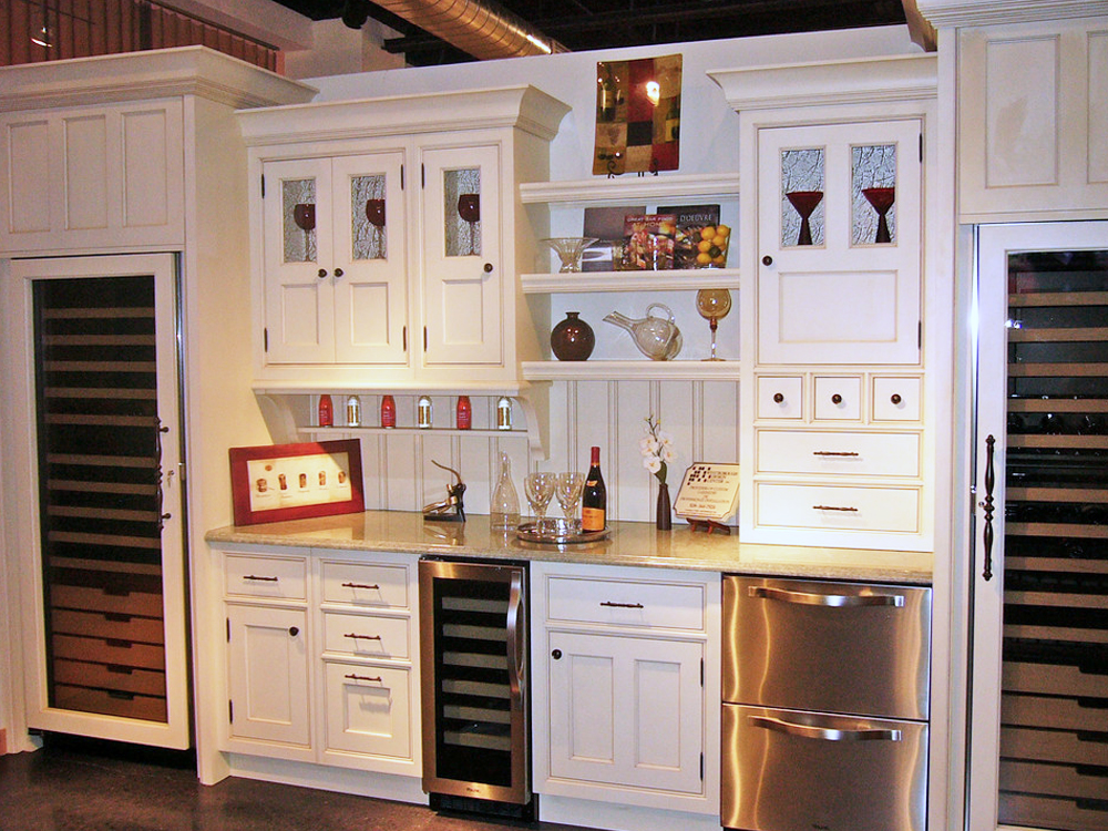 Take a minute to look at all of the details in this amazing kitchen... the customized cabinets are amazing. The wine refrigerators fit into the look perfectly. My favorite part is the detail work on the drawers - small details that make the big picture work!