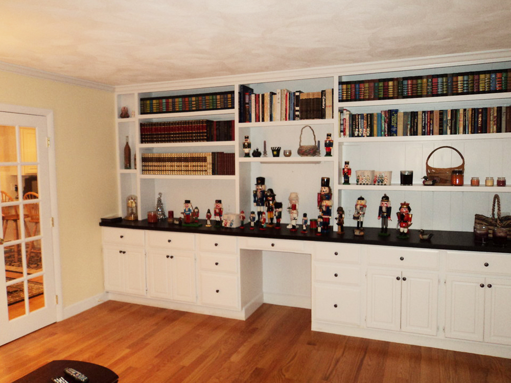 ho knew there were so many types of nutcrackers? This storage solution is another example of Don Wright's customized builtin bookshelves and cabinets. This piece even has a desk!