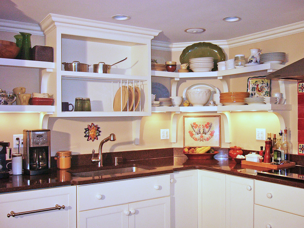 Custom shelves and cabinets give this kitchen an exceptionally warm feeling, without sacrificing beauty.