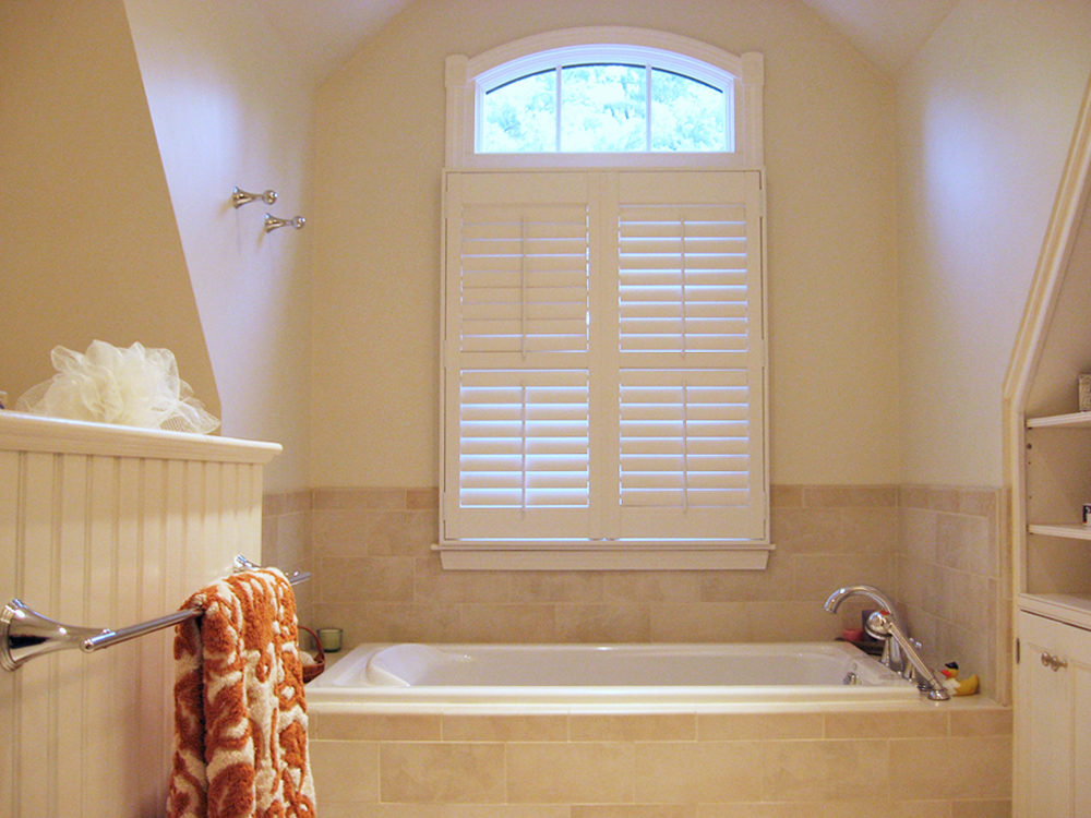 Tiled tub with custom curved window