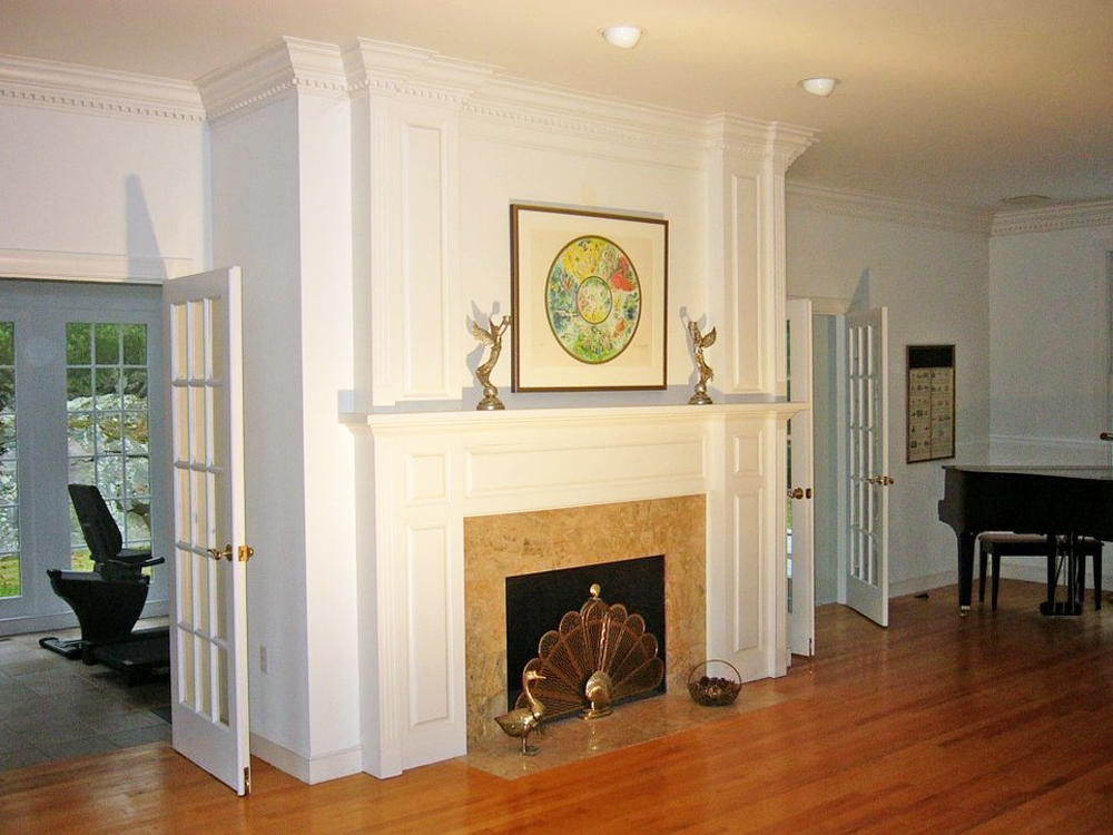 The fireplace and molding in this beautiful living room are gorgeous. Add the marble in the fireplace, wood floors and the french doors, and you have another perfect interior by Don Wright.