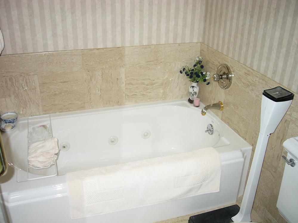 Stone tiled tub