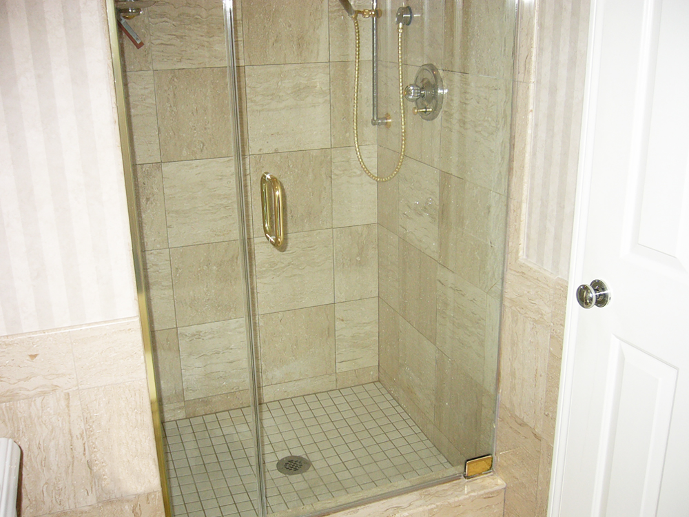 Glassed shower with granite tiles