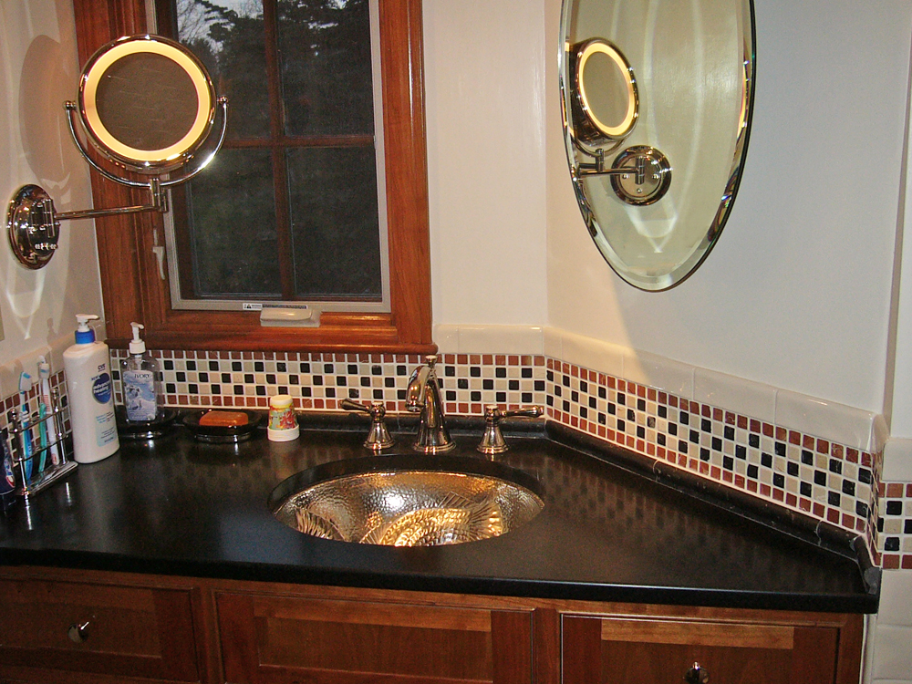 Beautiful tiles, and unique sink, combined with the elegant black counter and well placed windows make this sink perfect.