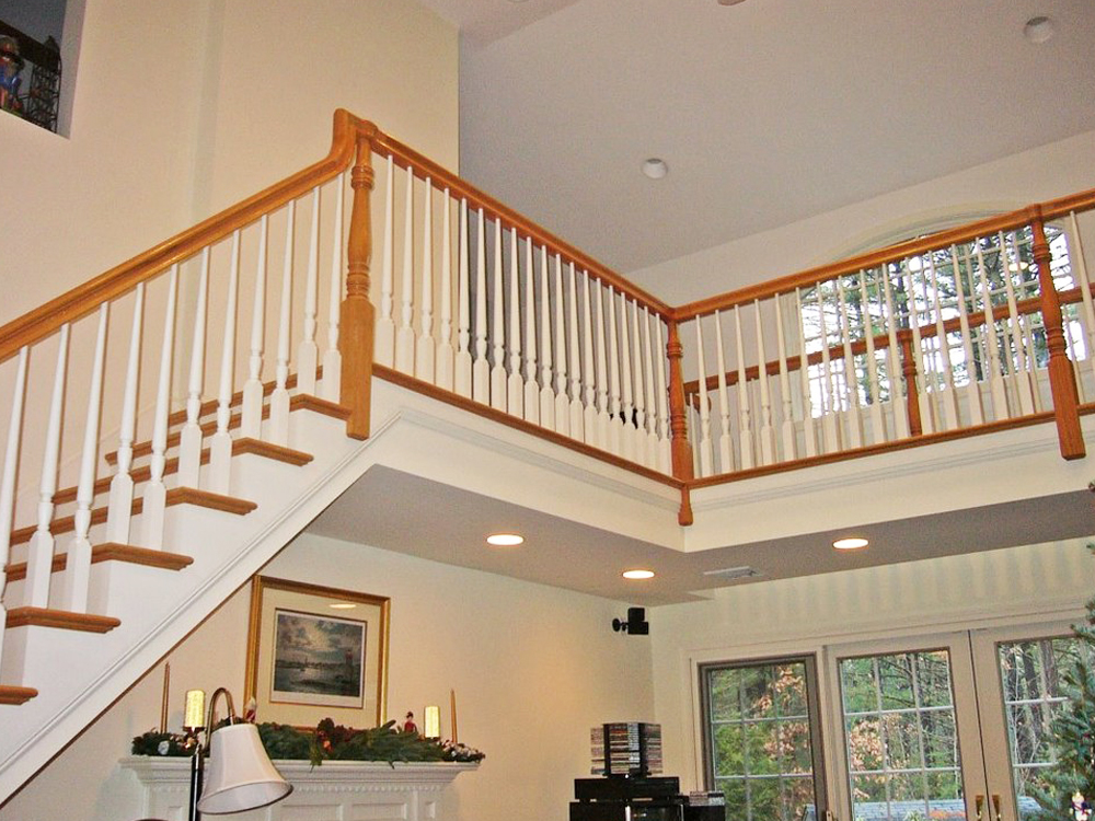 Every detail perfect - this large space is made more beautiful with the perfectly crafted railings. The light can come in through the upstairs custom window and the railings; and the upstairs and downstairs become one open living space. Note the hand-crafted natural wood framing!