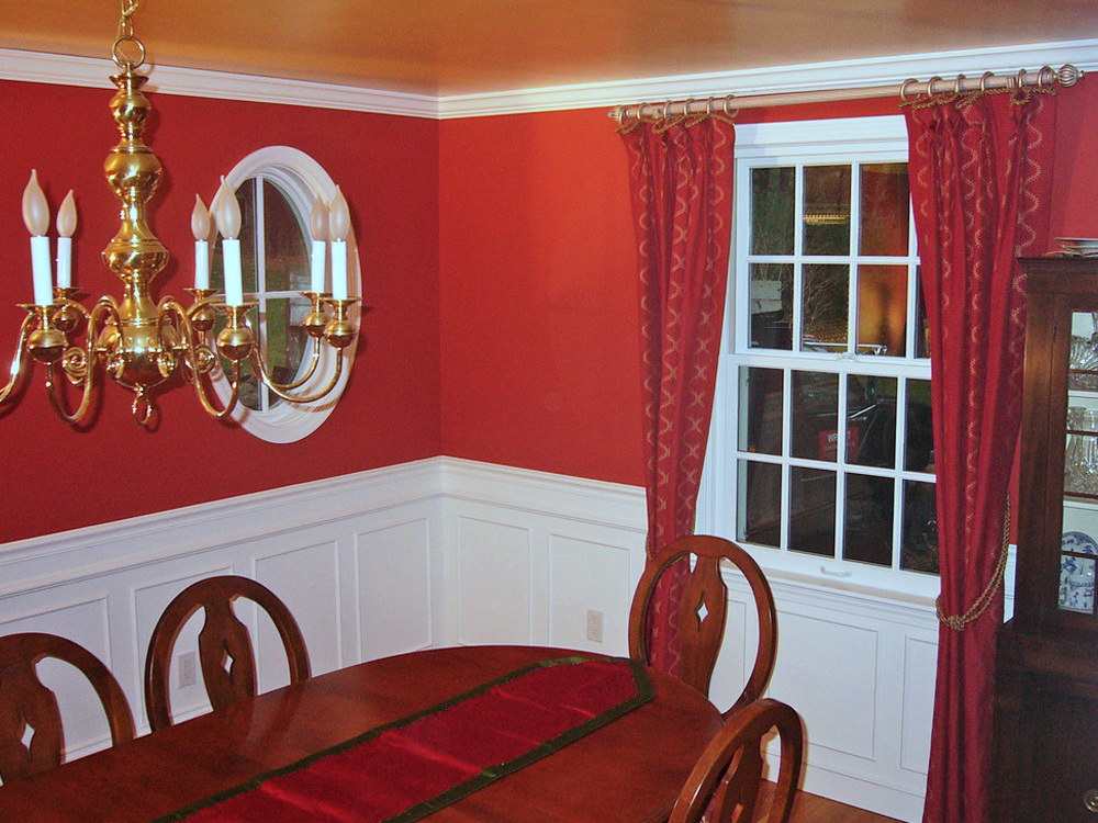 The round window and bottom paneling combine to make another unique room that works - by Don Wright!