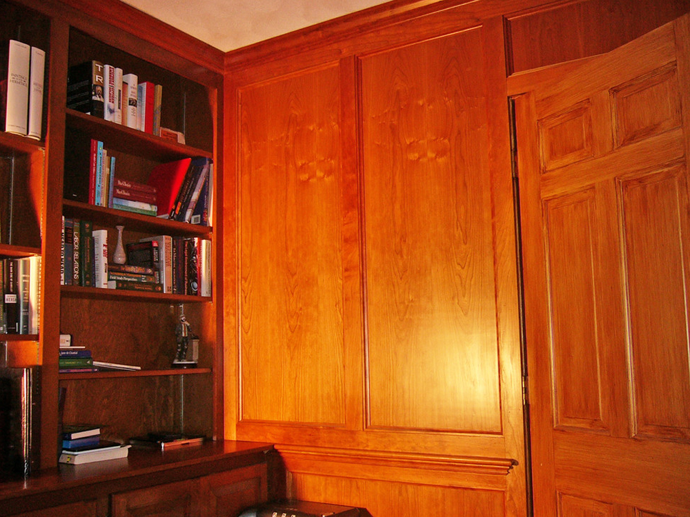 This wood paneling has a furniture-quality finish! Combined with builtin cabinets - the room is useful and beautiful.